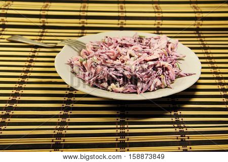 Сoleslaw salad of red cabbage with onion and mayonnaise