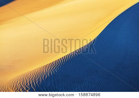 Beautiful sand dunes in desert at the sunrise.Death Valley,Neada,USA.