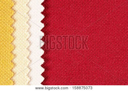 Background composition of colored stripes of serrated cotton fabric.place for text