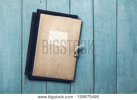 retro folder on old blue wooden background