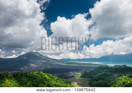 Caldera of the volcano of Batur at sunny day with clouds. Bali island, Indonesia