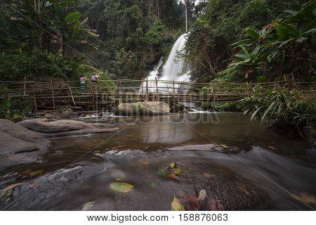 Motion blurred water of Pa Dok Siew Waterfall (Rak Jung waterfall ) beautiful waterfall in deep forest Doi Inthanon national park. Rainy season Chiangmai , Thailand