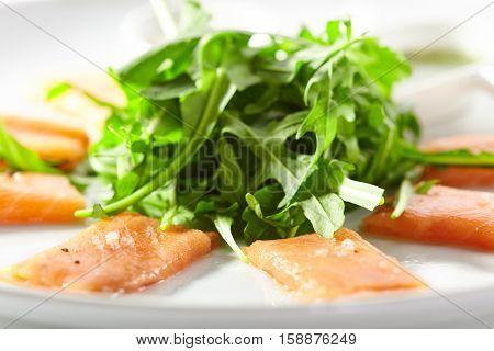 Fresh Salmon Carpaccio with Rocket and Pesto Sauce