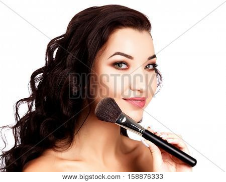 Pretty girl with a makeup brush, isolated on white background