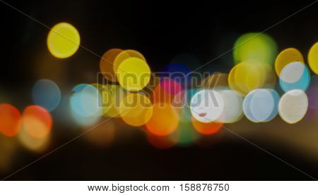 blurred lights of car on road at night. Background and bokeh for christmas and Newyear.