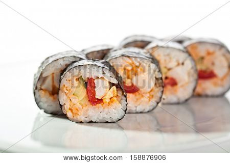 Sushi roll with Chicken Filled, Spicy Sauce, Bell Pepper and Cucumber