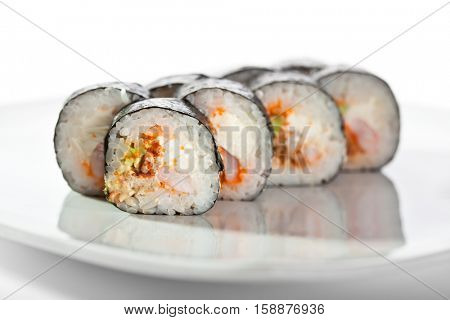 Sushi Roll with Shrimp, Smoked Eel, Avocado and Cream Cheese inside. Nori outside