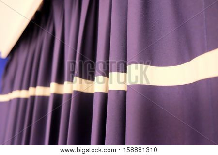 Elegant curtain and purple drapes, decoration in home