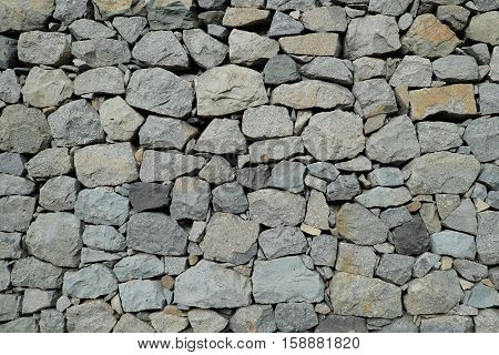 natural stone wall background - rubble wall