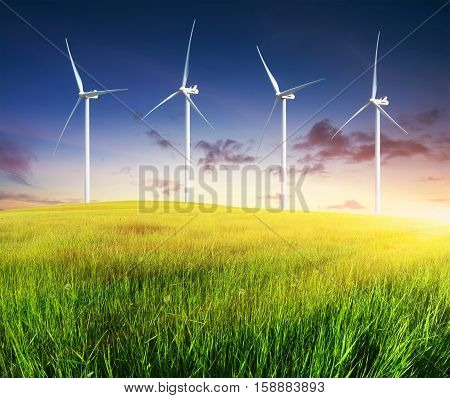 Wind power station on green field. Electrical technology
