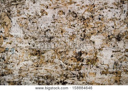 Abstract concrete background, bulletin board, grunge background, torn bulletins, wall texture