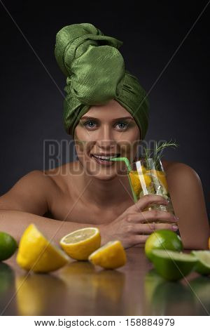 Young Woman With A Drink Of Lemon And Lime