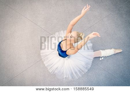 Ballet concept. Portrait of a beautiful graceful ballerina wearing tutu and pointe shoes.