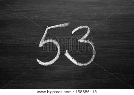 number fifty three enumeration written with a chalk on the blackboard