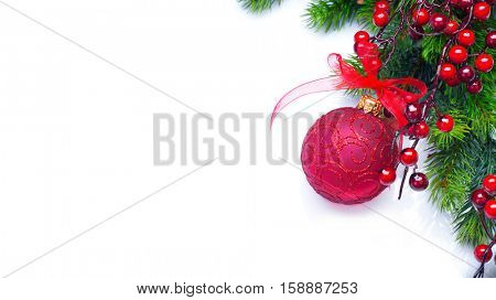 Red Christmas and New Year Decoration isolated on white background. Border art design with holiday baubles. Beautiful Christmas tree closeup decorated with ball, holly berry. Space for your text