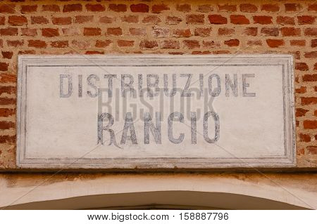 sign made of cement indicating the writing ration-distribution on a bricks wall