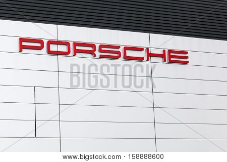 Le Mans, France - June 27, 2016: Porsche logo on a wall of a building. Porsche is a german automobile manufacturer specializing in high-performance sports cars