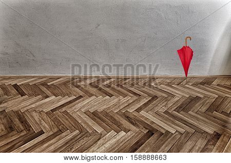 red umbrella on parquet floor and grunge wall