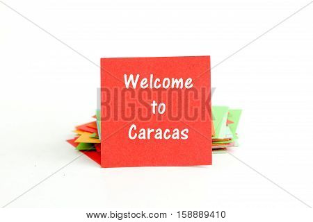 picture of a red note paper with text welcome to caracas