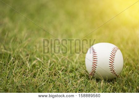 close-up baseball on the infield with sunlight