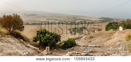Mediterranean rural landscape in autumn. View from the hill to the fields and Mediterranean Sea coast in thick mist Cyprus