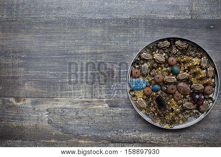 Small Beads On Wooden Background