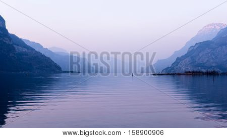 Relaxing landscape mountains and lake. Pastel colors evening light.