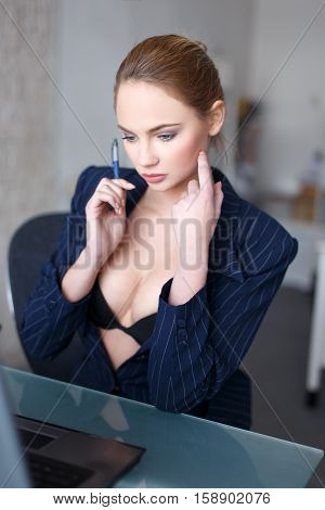 Sexy blonde woman in glasses online flirt in office undressing