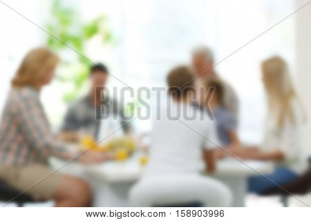 Happy family on kitchen. Blurred background