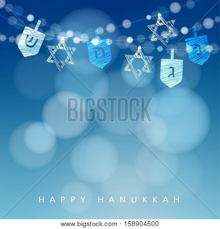 Hanukkah blue background with string of lights, dreidels and jewish stars. Festive party decoration. Modern blurred vector illustration for Jewish Festival of light.
