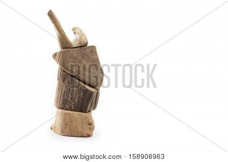 Pieces of drift wood stacked up to look like an deer or reindeer. Isolated on white