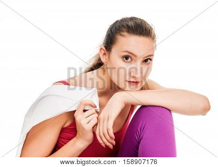 Fitness woman portrait isolated on white background. after workout with towel. tired