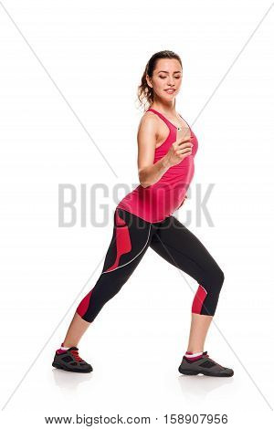 sport, fitness, lifestyle, technology and people concept - young woman with smartphone taking selfie on white background