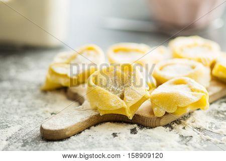 Italian traditional tortellini pasta and white flour.