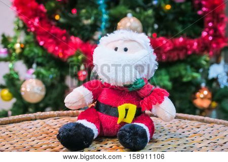 Santa Claus decorations and christmas tree background.