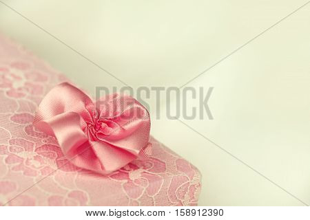 Pink lace gift box with a flower and floral ornament