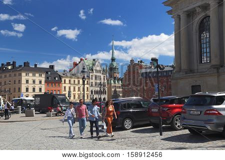 STOCKHOLM, SWEDEN - JUNE 27, 2016: Tourists walk on square Birger Jarl which is located on the island Riddarholmen in the Old Town.