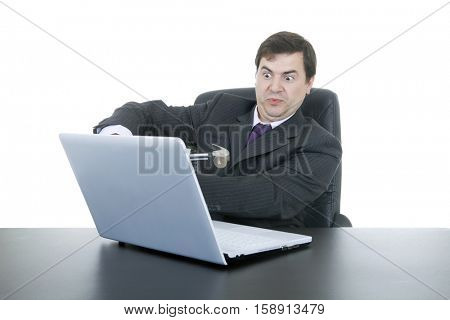 crazy businessman with a hammer smashing a laptop, isolated