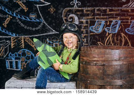 a boy with a toy model airplane on a Christmas background