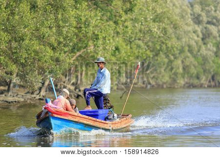 RANONG THAILAND - MARCH 18 :southern thai fishery in ranong province on long tail boat in ranong river on march 18 2015 in ranong thailand