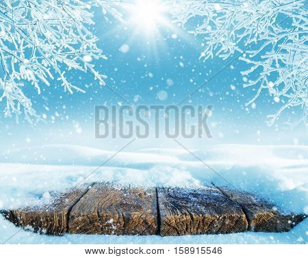 Winter bright background with snow-covered old table.