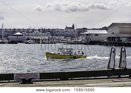 Portland Maine USA - August 9 2009: Water taxi makes its way into Casco Bay from Portland docks