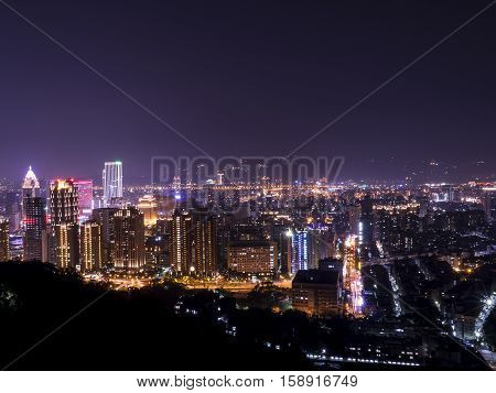 Cityscape nightlife view of Taipei. Taiwan city skyline at twilight time public scene from view point at Elephant Mountain Hiking Trail in purple tone