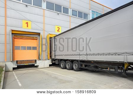 Loading Lorry Trailer at Warehouse Dock Gate