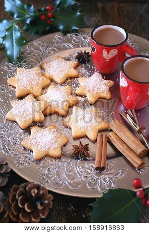 Homemade Christmas cookies and two cups of hot chocolate. Toned image