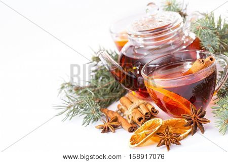 cup of hot tea and a teapot. cinnamon, anise, cookies and spruce branches on a white background. Christmas background