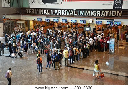 Travelers Enter Immigration Control At Changi International Airport