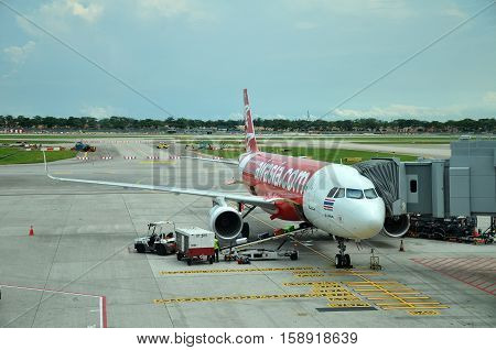 Unloading Of Baggage From The Air Asia Aircraft