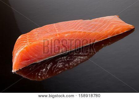 Salmon Fillet On Black Background.