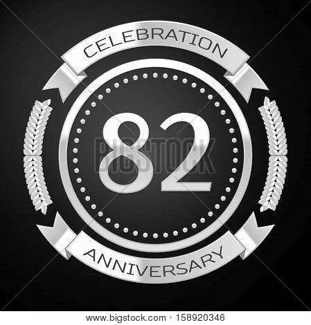 Eighty two years anniversary celebration with silver ring and ribbon on black background. Vector illustration